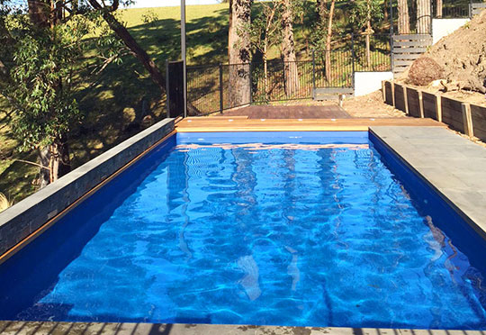above ground pool sloping sites