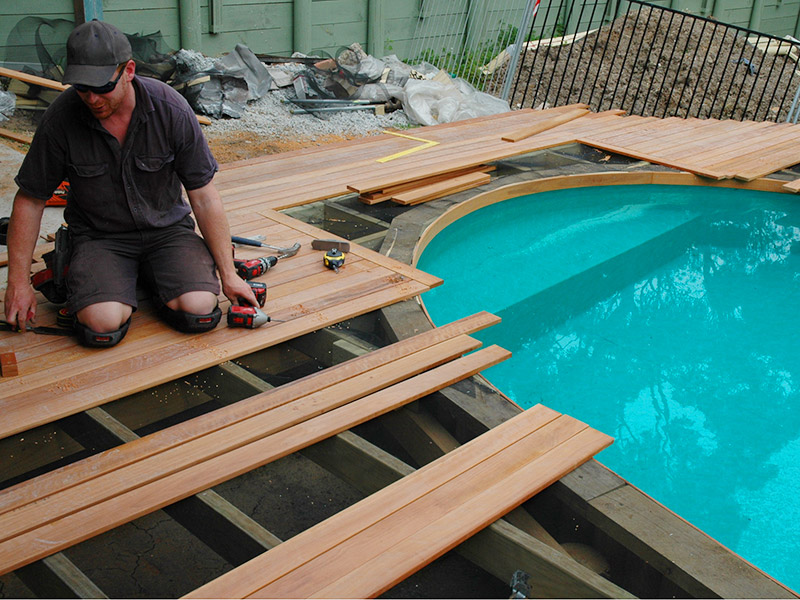 pool decking laid on pools top coping
