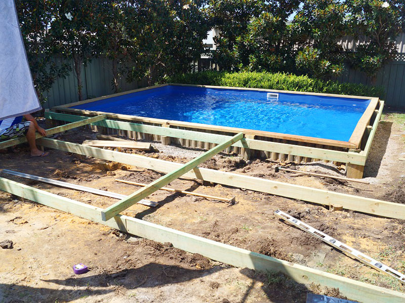 NSW - Brightwaters custom 6 x 4.4 Dark Blue. Decking about to be laid over the standard pool coping.