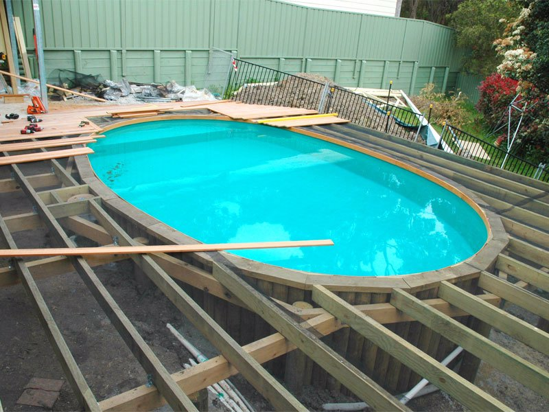 Decking being installed over the standard pool coping. Aqua Marble lining colour.